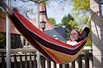 05/07/2012 - Medford/Somerville, Mass. - Carolyn Pace, E12, takes advantage of some good weather to spread out on her hammock to work on a paper on the roof of Tisch Library on May 7, 2012. (Kelvin Ma/Tufts University)