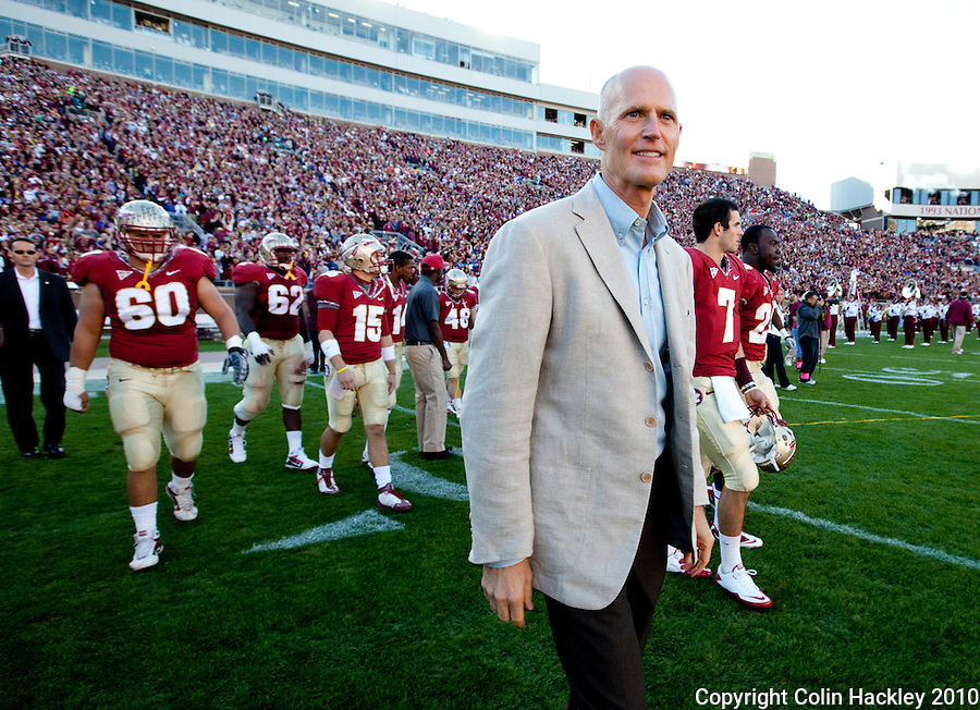 TALLAHASSEE, FL 11/27/10-FSU-UF FB10 CH-Gov.-elect Rick Scott, walks with Florida State players out to do the coin toss  prior to the Seminole's game against Florida, Saturday at Doak Campbell Stadium in Tallahassee. .COLIN HACKLEY PHOTO