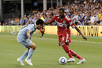 Cory Gibbs (5) Chicago Fire, Omar Bravo Sporting KC...Sporting KC and Chicago Fire played to a scoreless tie in the inaugural game at LIVESTRONG Sporting Park, Kansas City, Kansas.