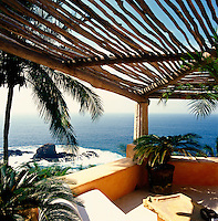 An exposed terrace has views out over the Pacific