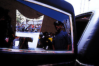 IN ADVANCE FOR 20TH ANNIVERSARY OF CROWN HEIGHTS RIOTS IN BROOKLYN, NY ON AUGUST 19, 1991. Spectators line up awaiting the removal of Gavin Cato's coffin from the Utica Ave. funeral home on August 26, 1991. Cato was the youth accidentally run over by the Lubavitcher Rebbe's auto procession in Crown Heights. (© Richard B. Levine)
