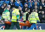 Anestis Argyriou in agony after slipping and going over on his ankle and stretchered off