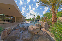 Rock boulders are used in landscaping of pool area
