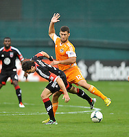 Dejan Jakovic (5) of D.C. United goes against Will Bruin (12) of the Houston Dynamo. The Houston Dynamo defeated D.C. United 4-0, at RFK Stadium, Wednesday May 8 , 2013.