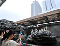 August 1, 2011, Tokyo, Japan - Penguins pose for visitors on the artificial rock at Shunshine City Aquarium in Tokyos Ikebukuro district on Monday, August 1, 2011. The main attraction at the 66-story landmark opens for general public on August 4 upon the completion of the 11-month renewal work. (Photo by Natsuki Sakai/AFLO) [3615] -mis-