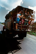 Cuba, March 1992: At the end of the day the tobacco workers are transported to their villages small buses or tractor trailers, Pinor del Rio, Cuba.
