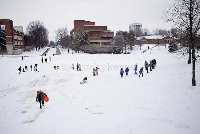 Students play in the snow after UK cancelled classes  outside William T. Young Library in Lexington, Ky., on Monday, February 3, 2014. Photo by Emily Wuetcher  | Staff