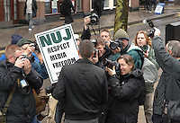 NUJ General Secretary demonstrates outside Scotland yard over Police harrassment of photographers and cameramen. The press release from the NUJ read as follows:.Photographers' rights protest at Scotland Yard..NUJ General Secretary, Jeremy Dear, will tomorrow (28/03) stage a .one-man protest outside the headquarters of the Metropolitan Police to .highlight the failure of law enforcement officers to protect media. freedoms...The union is frustrated that a large number of its photographer members. .continue to be regularly obstructed from doing their jobs by police .officers who don?t understand the law around media freedom. The one-man. .protest will aim to help senior police officers spot the difference .between a protester and photographers covering the protest...Last year a set of guidelines on dealing with the media was agreed .between the NUJ and the Association of Chief Police Officers, an .extension of guidelines already agreed with the Metropolitan Police. .However, cases have continued to surface of police officers taking .action that is not within their legal powers. Most cases involve .officers obstructing photographers from taking photos and the .confiscation or deletion of pictures once they have been taken...There are also examples of journalists being arrested, or threatened .with arrest, because they have refused to stop taking photos and in .other cases photographers have had their equipment seized. Many NUJ .members have reported being physically and mentally intimidated by the .police and some cases have included actual physical violence...Photographers regularly criticise the police for their handling of the .media at major events, particularly public demonstrations where. officers .often fail to draw a sufficient distinction between protestors and .members of the press who are reporting on the event...Jeremy Dear will deliver a letter to New Scotland Yard highlighting the. .union?s concerns and will stage his protest to help demonstrate the .diffe