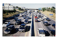 Fujifilm instax instant-film picture of Austin's infamous I-35 congested highway traffic during afternoon rush hour. Austin has the worst traffic in Texas. A new report from the Texas Department of Transportation (TxDOT) lists the most congested roadways in the state, and it should come as no surprise that I-35 takes the top spot - Stock Image.