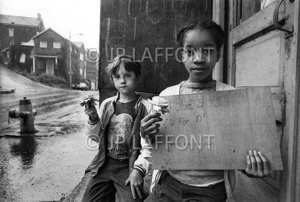 PA. June , 1980. <br /> Two children selling roses outside the city of Braddock.