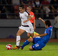 USWNT midfielder (11) Carli Lloyd steps through the tackle of Japanese midfielder (13) Ayumi Hara while playing at Worker's Stadium.  The USWNT defeated Japan, 4-2, during the semi-finals of the Beijing 2008 Olympics in Beijing, China.