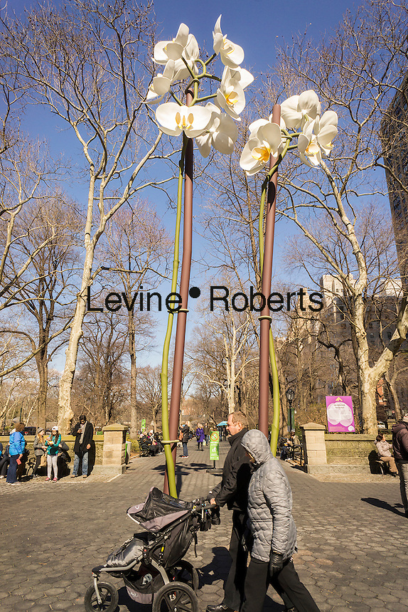 "Isa Genzken's ""Two Orchids"" are a harbinger of spring during its exhibit in the Doris C. Freedman Plaza of Central Park in New York on Sunday, March 6, 2016.  The 28 and 34 foot tall sculpture is constructed of stainless steel. The exhibition is sponsored by the Public Art Fund and will be on view until August 21, 2016.  (© Richard B. Levine)"