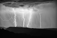 Like something out of Cinderella, three angry strikes of lightning overshadow one plainly dressed, solitary strike.