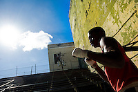 A Cuban boxer trains at Rafael Trejo boxing gym in the Old Havana, Cuba, 5 February 2010. During the last 30 years Cuba has produced more World Champions and Olympic gold medallists in amateur boxing than any other country. Many famous fighters, who came out of Cuba, were training at Rafael Trejo boxing gym in their youth. This run down open air facility in the Old Havana is a place of learning and mastering the art of boxing by the old school style. Boys begin their training very young. As sports are given a high political priority in Cuba, all children are systematically encouraged to develop their skills. Those who succeed will become heroes of Cuban society.