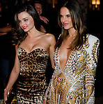 Victoria's Secret Angels Miranda Kerr, Left, and Alessandra Ambrosio arrive to the Pink Carpet before Tuesday's viewing party for the 2011 Victoria's Secret Fashion Show at the Samueli Theater at the Segerstrom Center for the Arts in Costa Mesa