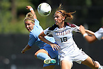 11 September 2011: North Carolina's Amber Brooks (left) and Texas A&M's Kat Bartley (18). The Texas A&M Aggies defeated the University of North Carolina Tar Heels 4-3 in overtime at Koskinen Stadium in Durham, North Carolina in an NCAA Division I Women's Soccer game.
