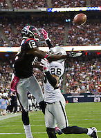 HOUSTON, TX - OCTOBER 9:   Jacoby Jones #12 of the Houston Texans tries to catch a touchdown pass over Stanford Routt #26 of the Oakland Raiders at Reliant Stadium on October 9, 2011 in Houston, Texas.  The Raiders defeated the Texans 25 to 20.  (Photo by Wesley Hitt/Getty Images) *** Local Caption *** Jacoby Jones; Stanford Routt