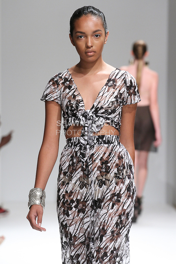 Model walks runway in a swimwear from the Treasure Hur Spring Summer 2015 collection, by Treasure Simmons, at Fashion Gallery New York Fashion Week Spring Summer 2015, during New York Fashion Week Spring 2015.