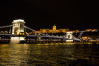 Cityscape showing the Castle of Buda (back) and the Chain Bridge (front) before the Earth Hour blackout in Budapest, Hungary on March 31, 2012. ATTILA VOLGYI