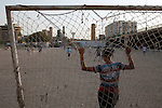 Iraqi boys play soccer in a dusty lot in Baghdad, Iraq August 26, 2010.   .