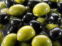 Fresh mixed black and green olives photos, pictures & images.