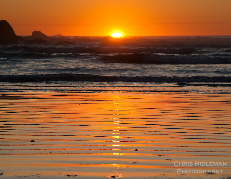Gift card photo of Sunset on the Oregon Coast at low tide causing ripples in the sand. Light from sun causes great shadow effect.