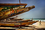 Fishing boats line the beach at the port in the Mauritanian capital Nouakchott May 20, 2008. Mauritania is a country of 3 million people located in North-West Africa.  .