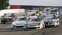 The #87 Porsche of Leh Keen and Dirk Werner leads the GT field into turn one at the start of the Crown Royal 200 Grand-Am Rolex Series race at Watkins Glen International Raceway, Watkins Glen, NY, August 2009. (Photo by Brian Cleary/www.bcpix.com)