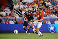 Dimitar Berbatov (9) of Manchester United gets past Geoff Cameron (20) of the MLS All-Stars. Manchester United defeated the MLS All-Stars 4-0 during the MLS ALL-Star game at Red Bull Arena in Harrison, NJ, on July 27, 2011.