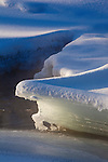 Early morning sunlight on the snow and ice covered Blackfoot River below Roundup Rapids in Montana