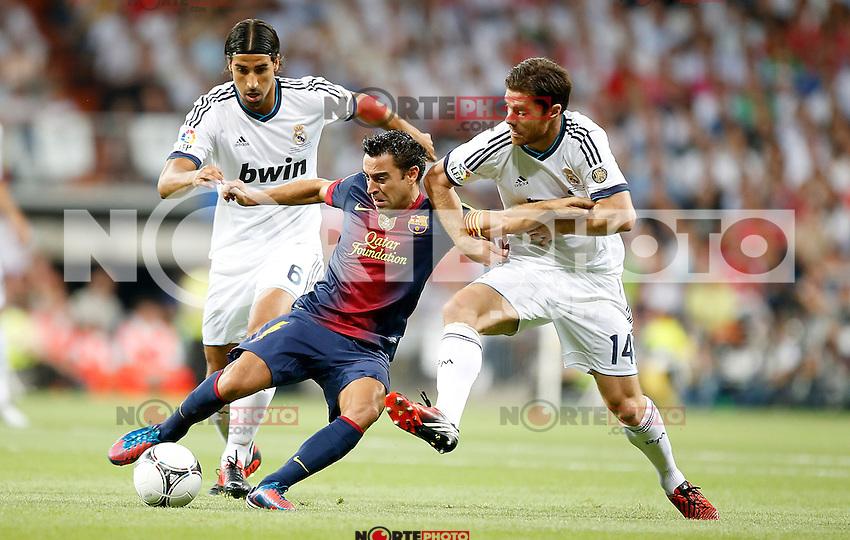 Real Madrid's Sami Khedira and Xabi Alonso against Barcelona's Xavi Hernandez during Super Cup match. August 29, 2012. (ALTERPHOTOS/Alvaro Hernandez). NortePhoto.com
