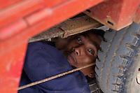 Driver is fixing his Tuk-Tuk in Battambang, Cambodia