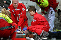 A doctor and a rescue professional performing CPR on man with heart failiure. Pictures of Norwegian Air Ambulance at work, operating out of Trondheim. The helicopter crew consist of a pilot, a crew member/rescue professional, and a physician.