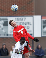University of New Mexico defender Travis Campbell (6) and University of Connecticut forward Mamadou Diouf (23) battle for head ball. .NCAA Tournament. With a goal in the second overtime, University of Connecticut (white) defeated University of New Mexico (red), 2-1, at Morrone Stadium at University of Connecticut on November 25, 2012.