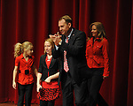 New Ole Miss head football coach Hugh Freeze claps as he enters a press conference with his family announcing his hiring at the Ford Center on campus in Oxford, Miss. on Monday, December 5, 2011.