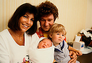 Montreal, Canada - June 30, 1979. This photograph was taken of Robert with his wife, Laurence, Victor (18 months) and newly born son Jerome at the hospital. Robert Charlebois (born June 25, 1944) is a Quebec author, composer, musician, performer and actor. He is an important figure in French music and his best known songs include Lindberg and Je reviendrai à Montréal.