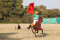 A 61st Cavalry rider rides at full speed past the spectators after a game between the Royal Jaipur Polo Team and the Western Australia Polo Team for the Argyle Pink Diamond Cup, organised as part of the 2013 Oz Fest in the Rajasthan Polo Club grounds in Jaipur, Rajasthan, India on 10th January 2013. Photo by Suzanne Lee