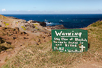 A warning sign along the trail leading to the Nakalele blowhole, West Maui.