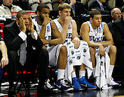 The Duke bench watches the final minute of the game. Lehigh defeated Duke 75-70 during the 2nd round of the 2012 NCAA Basketball Championship at the Greensboro Coliseum in Greensboro, NC. Photo by Al Drago.