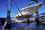 Cleaning the hull in the boat yard, Puerto Colon,Tenerife, Canary Islands, Spain