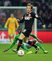 FUSSBALL   1. BUNDESLIGA   SAISON 2012/2013    24. SPIELTAG SV Werder Bremen - FC Augsburg                           02.03.2013 Assani Lukimya (hinten, SV Werder Bremen) gegen Andreas Ottl (vorn, Augsburg)