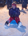 Anna Renfroe sleds while playing in the snowfall in Oxford, Miss. on Sunday, January 9, 2011. The snowfall in the Oxford area has caused the closing of area schools on Monday, including the University of Mississippi. (AP Photo/Oxford Eagle, Bruce Newman) MAGS OUT NO SALES MANDTORY CREDIT