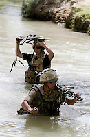 Private Aaron Holmes 19 and Private Paul Willmott 12 from the Worcester and Sherwood Forest Regiment  search the Helmand river inside the Greenzone, Southern Afghanistan PRESS ASSOCIATION Photo. Picture date:Saturday 11th August  , 2007. Photo credit should read: Andrew Parsons/PA.