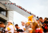 Cincinnati Bengals fans leave along the escalator in the fourth quarter against the Pittsburgh Steelers during the game at Paul Brown Stadium on December 12, 2015 in Cincinnati, Ohio. (Photo by Jared Wickerham/DKPittsburghSports)