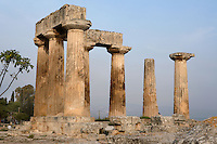 CORINTH, GREECE - APRIL 16 : A view from behind of the Temple of Apollo, on April 16, 2007 in Corinth, Greece. Standing prominently on a knoll the Temple of Apollo was built in the 7th century BC in the Doric Order. Seven of its original 38 columns remain standing and are seen here in the early morning light. It is one of the oldest temples in Greece. Corinth, founded in Neolithic times, was a major Ancient Greek city, until it was razed by the Romans in 146 BC. Rebuilt a century later it was destroyed by an earthquake in Byzantine times.(Photo by Manuel Cohen)