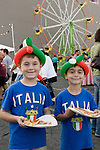 Two boys with Italia shirts and balloon hats holding slices of pizza at the Feast of San Gennaro - Los Angeles - a four day Italian festival in Hollywood, CA