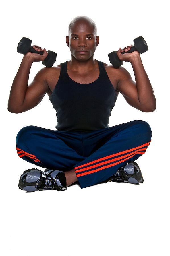 Young Body Builder African American doing excersice in the floor.