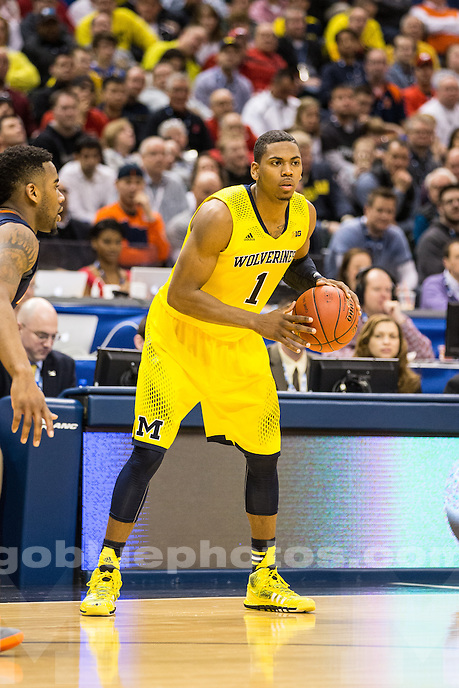 The University of Michigan men's basketball team defeats Illinois, 63-62, in the quarterfinals of the Big Ten Tournament to advance to the semifinals at Banker's Life Fieldhouse in Indianapolis, Ind., on March 14, 2014.