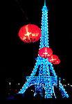 Chinese Lantern Festival in Toronto. Eiffel tower symbol of France. Colorful magnificent illumination glowing at night. Ontario Place, Toronto, Ontario, Canada 2008.