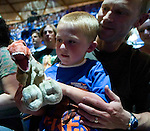 Five-year-old Scott, held by his father Steve Brewer, plays with a stuffed T-Rex while attending Walking with Dinosaurs at the Tacoma Dome in Tacoma, Washington on July, 11, 2007.  The 90- minute show,  based on the award-winning BBC Television series kicked off it's seven city tour in the U.S. and Canada. 15 dinosaurs, which roamed the earth about 208 million years ago, have been brought back to life via truck batteries, hydraulics and puppeteers in the 90-minute show, Walking with Dinosaurs - The Live Experience, based on the award-winning BBC Television series kicked off it's seven city Summer tour in the U.S. and Canada.  (&copy; 2007 Jim Bryant Photography)..